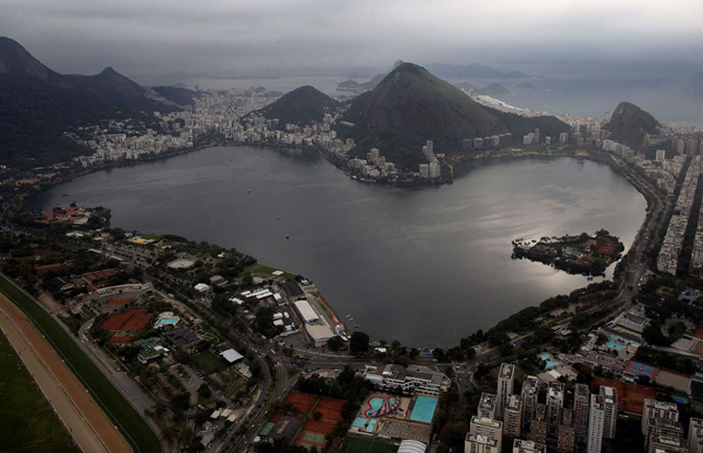 This 27 July 2015 aerial photo shows the Rodrigo de Freitas Lake in Rio de Janeiro, Brazil. An Associated Press analysis of water quality found dangerously high levels of viruses and bacteria from human sewage in Olympic and Paralympic venues. The Rodrigo de Freitas Lake, which was largely cleaned up in recent years, was thought be safe for rowers and canoers. Yet AP tests found its waters to be among the most polluted for Olympic sites. Photo: Leo Correa / AP Photo