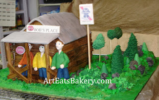 Bob's Place bar fondant cake with edible wood siding, signs, sugar figures, trees and grass