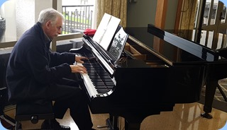 Claude Moffat playing the K. Kawai grand piano.