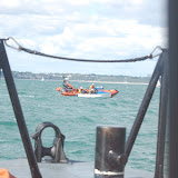 30 August 2012 - Mudeford and Poole lifeboats alongside an open boat that had been struggling with the tide and wind conditions in Poole Bay on the first day of the Bournemouth Air Show. Photo: RNLI Poole/Dave Riley