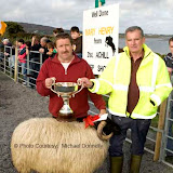John Nolan, Newport is presented with the John Patten Cup by Irvin Moran (Achill Sheep Show Committee) for Best Ram Lamb (Open) class at the 21st Achill Sheep Show (Taispeántas Caorach Acla 2007) at Pattens Bar, Derreens Achill. Photo: © Michael Donnelly