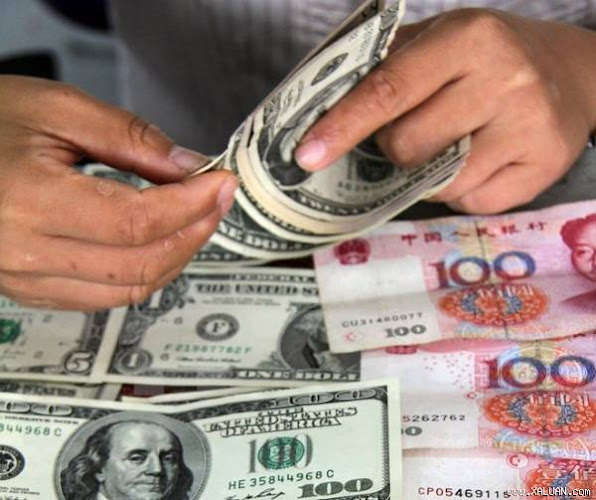Kiem dong USD va dong nhan dan te tai ngan hang o Son Dong