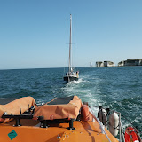 Poole ALB towing a yacht back to Poole Quay Boat Haven from Studland Bay. 22 August 2013 Photo: RNLI/Anne Millman
