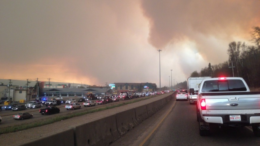 Tens of thousands flee devastating wildfire