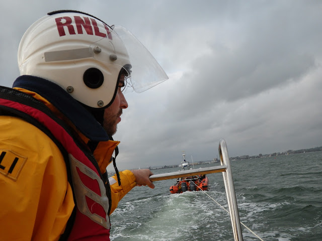Crew Member Chris Speers keeping an eye on the tow rope as Poole ILB tows Dolphin III during a training exercise - 22 April 2014 Photo: RNLI Poole/Anne Millman