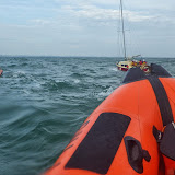 Swanage D-class lifeboat escorts the yacht south of Old Harry Rocks - 28 September 2013. Photo credit: RNLI / Rob Inett