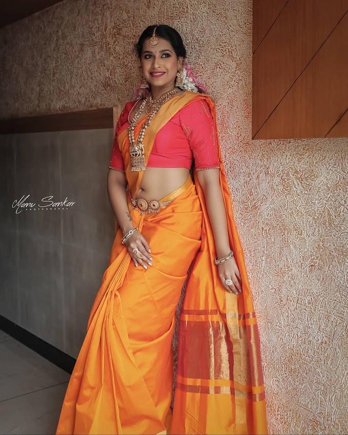 Sadhika Venugopal navel photos in wedding saree.