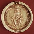 Photo: Louis VII, roi de France (1137-1180), d'après une empreinte de 1175 - Moulage, Paris, Archives nationales de France, sc/D37 (Dalas, Corpus. Rois, n° 67) - diam. 73 mm - Légende : /LVDOVICVS D(e)I GR(aci)A / FRANCORVM REX/ (Louis, par la grâce de Dieu roi de France)
