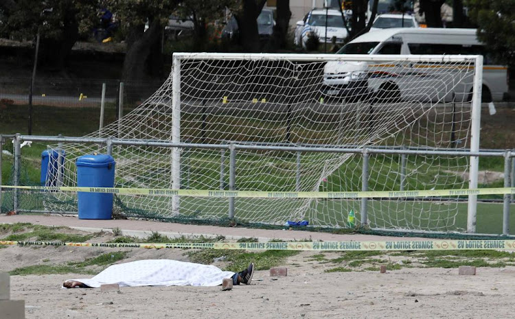 A body lies on a sports field following taxi violence in Hout Bay on Monday last week..