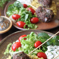 ground beef kabobs with plates with lettuce and tomato