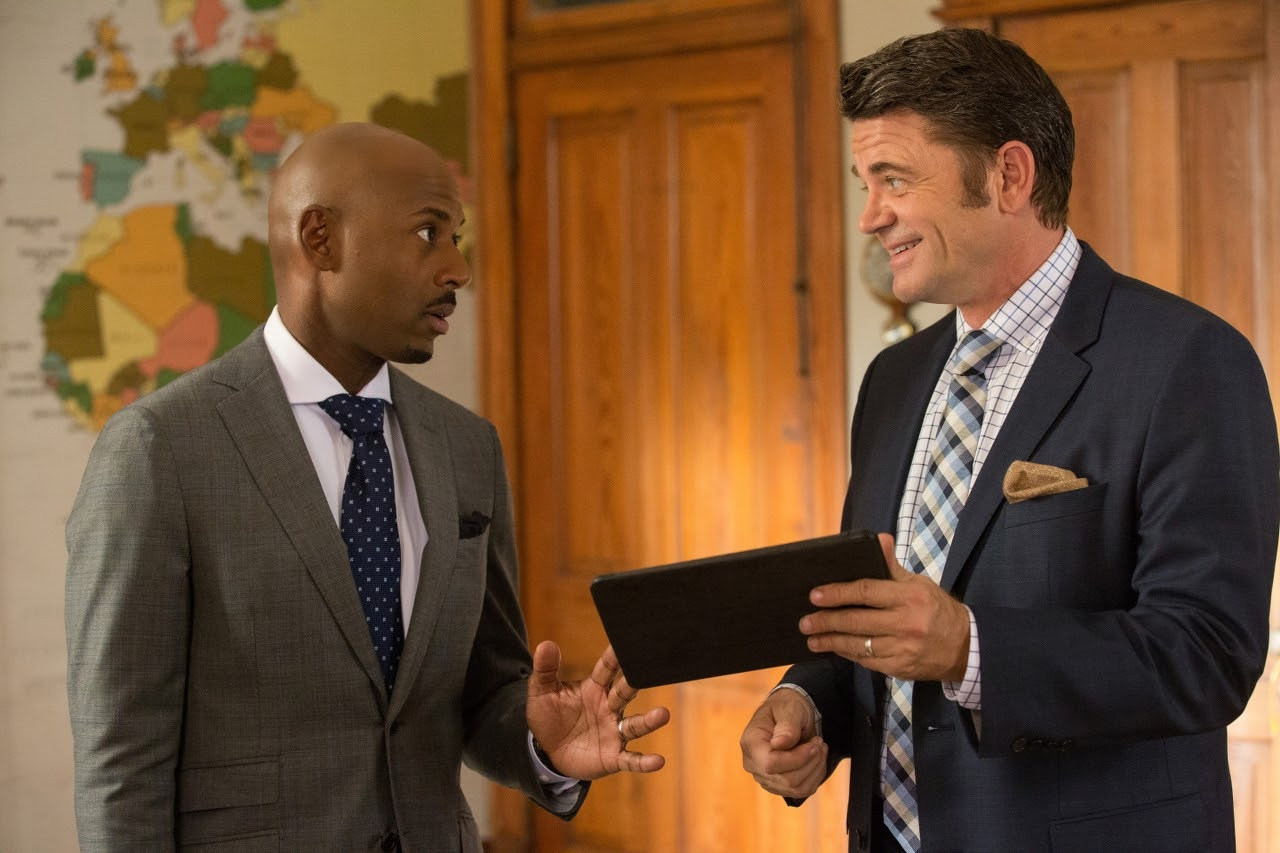 (L to R) Romany Malco and John Michael Higgins in ALMOST CHRISTMAS. (Photo by Quantrell D. Colbert / courtesy of Universal Pictures).