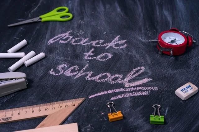 Back to school words written on a blackboard