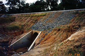 Photo: AUS-HYDR05 - Australia this culvert and road fill should be protected by vetiver