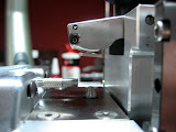 Side view of the Counterbore Precision Measurement Machine.  The slide and holding arm are in the part-loading position.