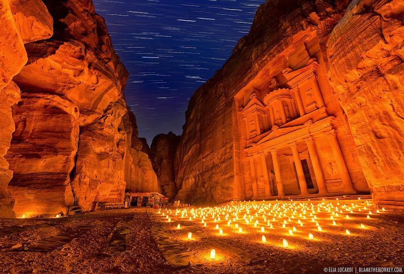 As the stars dance above the treasury in the ancient site of Petra Jordan. Photographer Elia Locardi