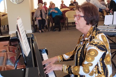 Mary Elvin playing the grand piano. Photo courtesy of Dennis Lyons.