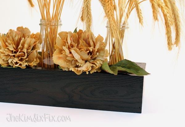 Adding burlap flowers to centerpiece