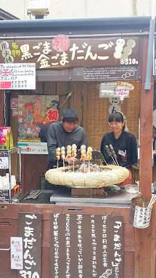 Getting a little crisp edge to the dango, a chewy Japanese dumpling and sweet made from mochiko (rice flour) that are served skewered at a Mount Takao stand