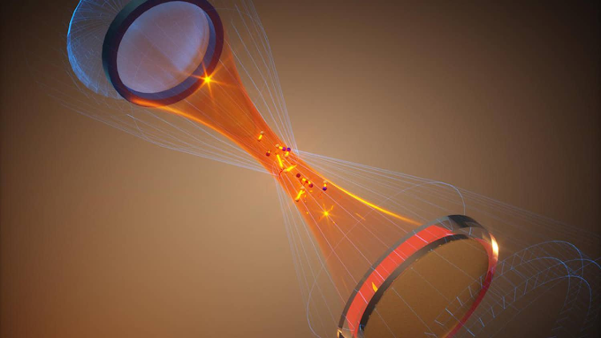 SCIENTISTS PAVE WAY FOR PHOTONS TO INTERACT WITH A PAIR ATOMS