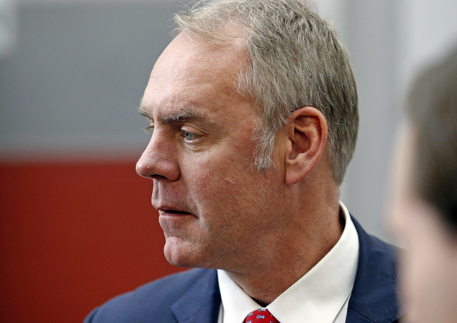 In this 9 February 2018 file photo, U.S. Interior Secretary Ryan Zinke walks through the Western Conservation and Hunting Expo in Salt Lake City. Zinke said Tuesday, March 6, that his agency should be a partner with energy companies that seek to drill for oil and gas on public land. Photo: Rick Bowmer / AP Photo