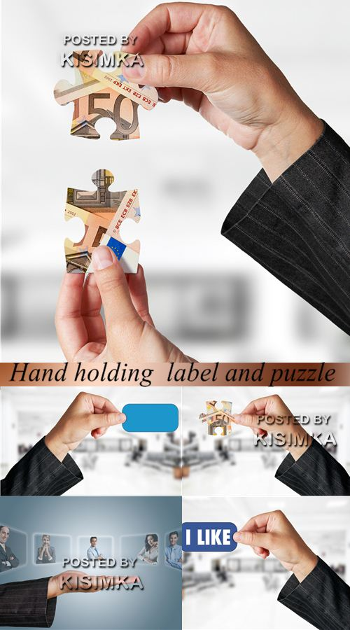 Stock Photo: Hand holding label and puzzle