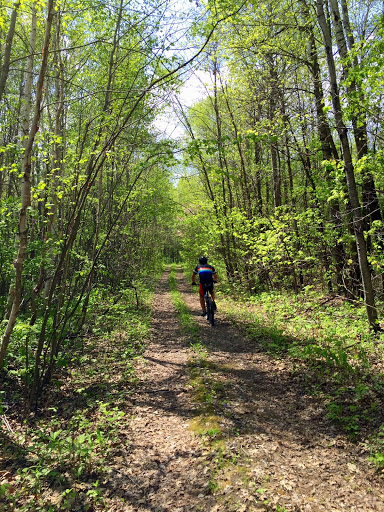 Pat Crary on a forest road north of the Maplelag trails. There are lot of areas forest roads and trails that make for great riding. Check with us where to go~!
