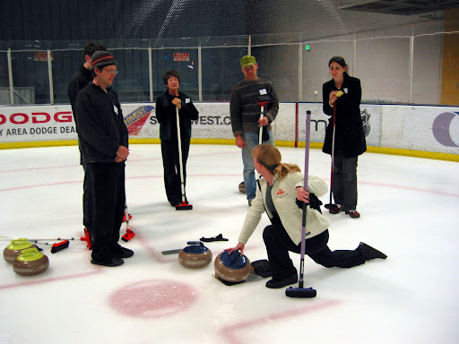 Barbara F. demonstrates the curling slide at an open house. (Sharks Ice Fremont, 2008)