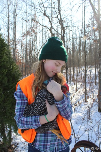 Hailey and one of her chickens