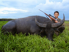 Young Mr Adrian Sunito with his first big game... water buffalo.
