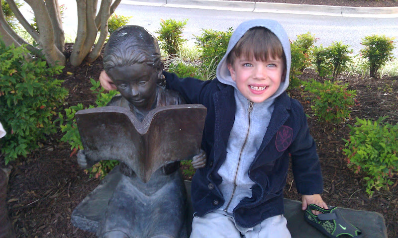 Ian posing with a statue