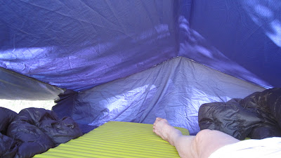 The foot of the tent, and the foot of M.©http://backpackthesierra.com