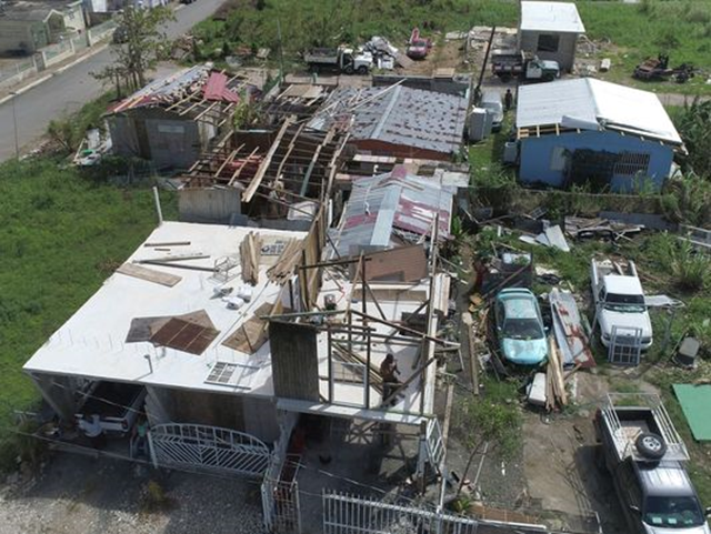 The coastal surge from Hurricane Maria reached up to 5 feet or more devastating the town of Toa Baja in Puerto Rico which can be seen in the water lines on homes 1 October 2017. In addition to flooding many homes also lost their roofs leaving many people exposed to the elements or forcing them to abandoned their homes. Photo: Ricky Flores / Carrie Cochran / USA TODAY NETWORK