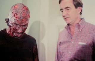 Conferring with director Wes Craven.
