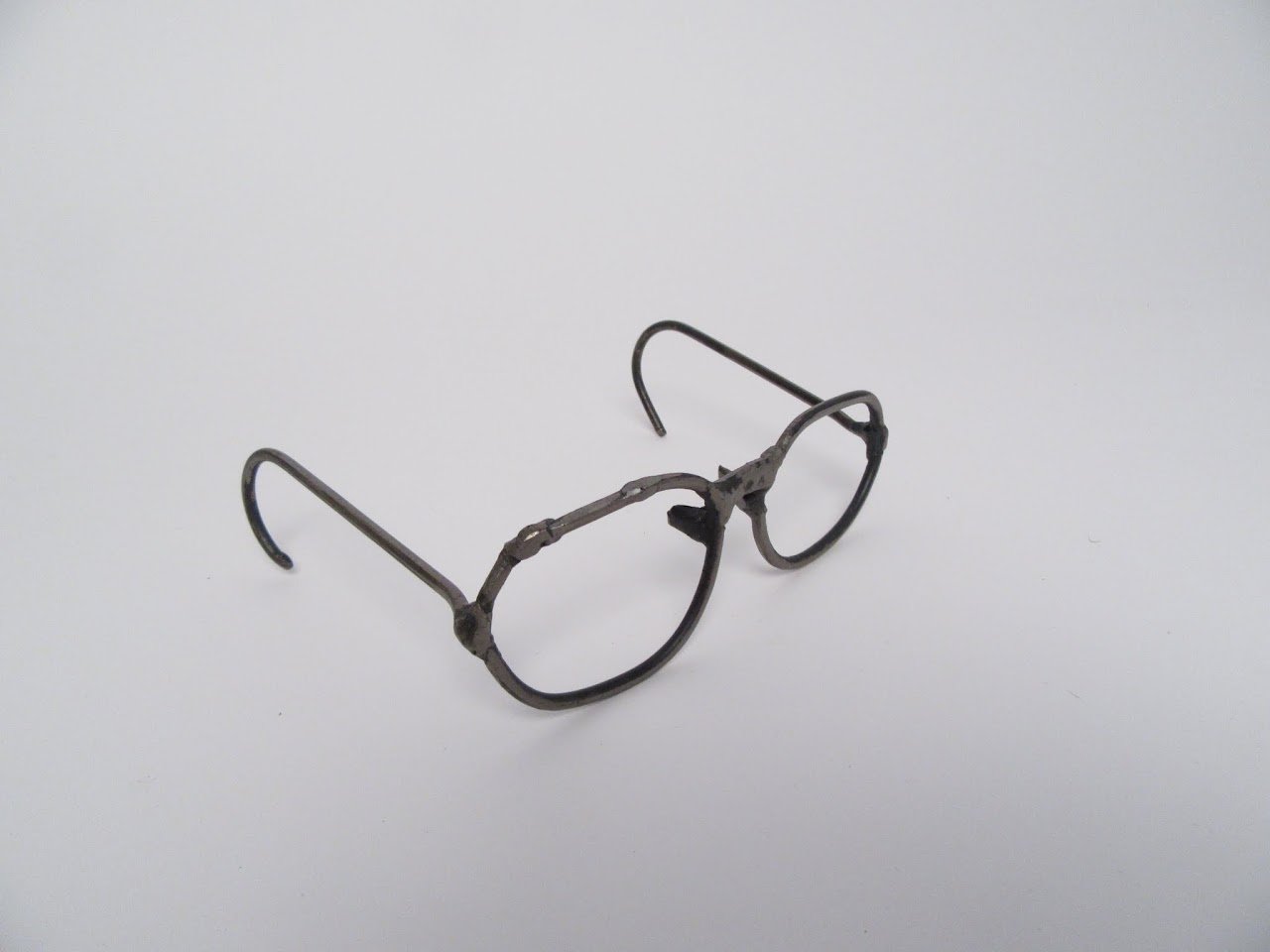 Unsigned Metal Sculpture of Glasses