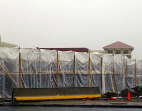 Photo: The S. Winton Road side of Wegmans looks disturbingly like a prison... complete with guard towers.