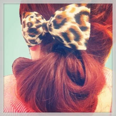 side bun with leopard print bow quick and easy pinup hairstyle