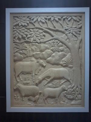 Relief batu paras putih asal jogja