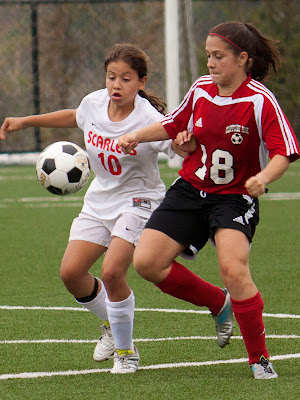 Ridgefield Park # 10 Ashley Castilo and Cliffside Park # 18 Maria Villado battle for the ball during the first overtime period.   Photos by TOM HART/  FREELANCE PHOTOGRAPHER.