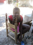 Ruth, 12, whose leg was amputated, is painfully shy. She rarely talks and is very conscientious of her missing leg.