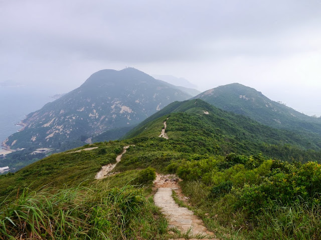 view of mountains and the sea from Dragon's Back trail in Hong Kong