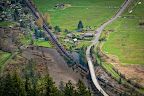 Please credit Paul K. Anderson Blanchard, Washington at the foot of the Chuckanut Range sits nestled amongst organic farms and dairies. A coal train heads north to the Westshore Coal Terminal just across the border at Roberts Bank, British Columbia.