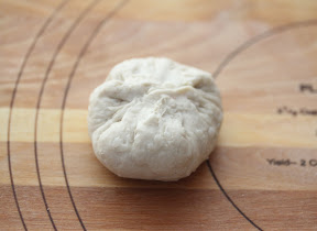 process photo showing how to wrap the dough around the filling