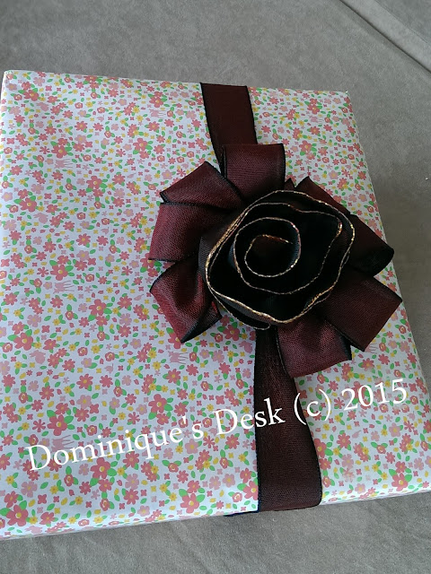 The bow and rose used as decoration on a box