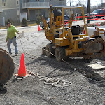 Pulling new electric cable through underground conduit