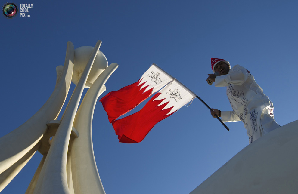 Bahrain - protester at Pearl monument