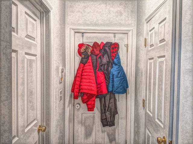 Jackets hanging behind door free pictures