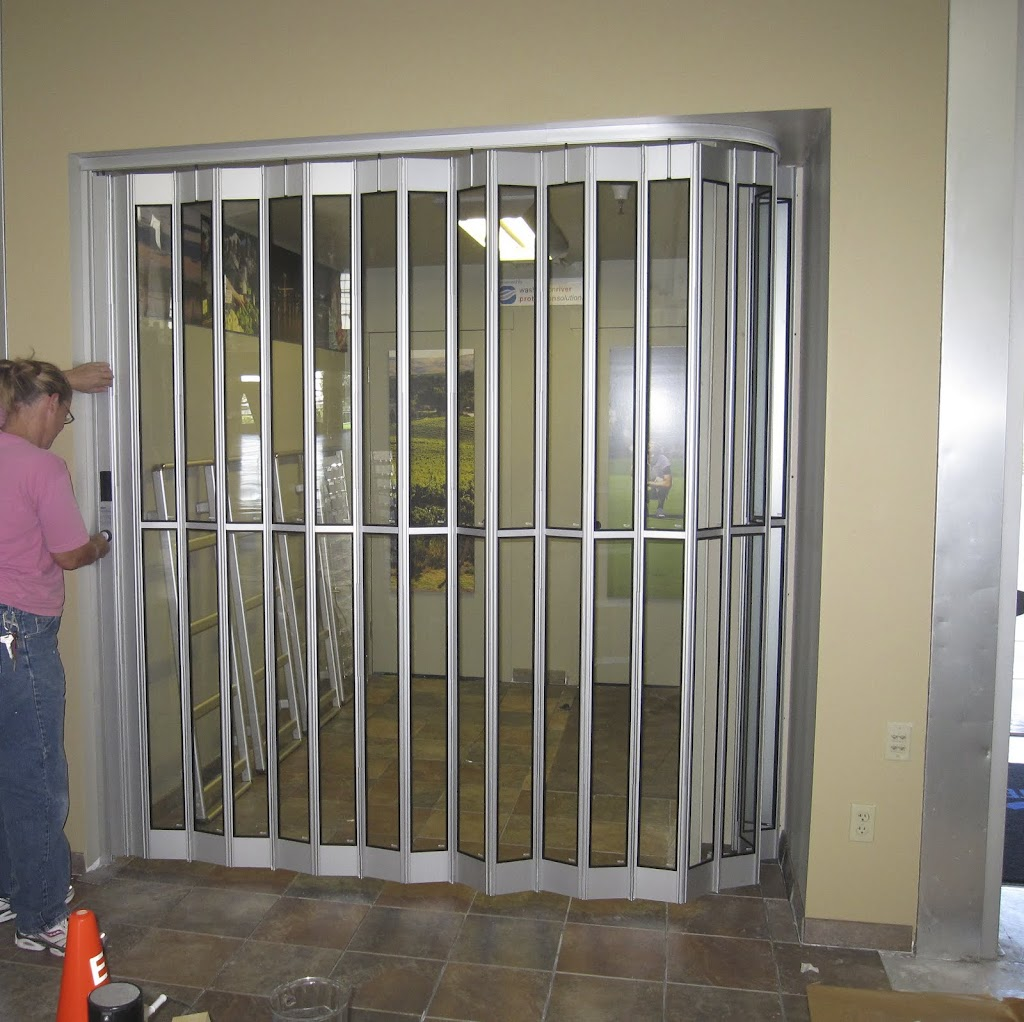 "One of the project requirements was to include a way to secure the space.  We found this secure folding door in a material that would match the brochure racks.  The door folds into a pocket that measures about 1'x30""."
