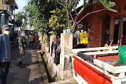 Tingkatkan PPKM Skala Mikro Tingkat Desa Babinsa Kodim 0619/PWK Laksanakan Penyemprotan Disinfektan