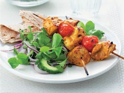 Chicken tikka skewers with cucumber salad
