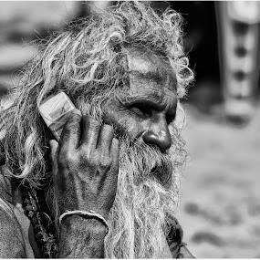 Nokia Connecting people :-) by Subroto Mukherjee - News & Events World Events ( monochrome, nokia, men, sadhu, portrait )